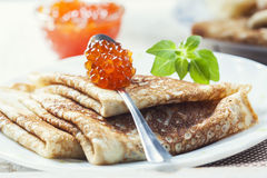 Pancakes with salmon caviar,  traditional Russian meal Stock Photo