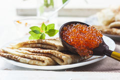 Pancakes with salmon caviar,  traditional Russian meal Royalty Free Stock Image