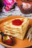 Pancakes with salmon caviar Stock Photo