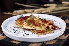 Pancakes with salmon caviar Royalty Free Stock Image