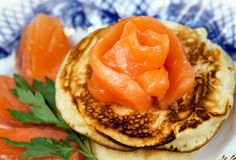 Pancakes with salmon fish Stock Photos