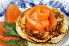 Pancakes with salmon fish stock photos