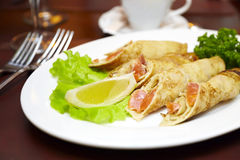Pancakes with a salmon on a plate Stock Photography
