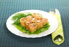 Pancakes with salmon and salad Stock Image
