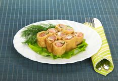 Pancakes with salmon and salad Royalty Free Stock Images