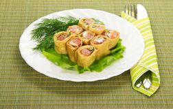 Pancakes with salmon and salad, cutlery Stock Image