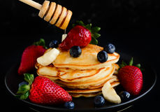 Pancakes served with berries and apples Royalty Free Stock Image