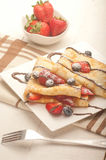 Pancakes served with strawberries, blueberries and chocolate Stock Images