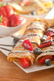 Pancakes served with strawberries, blueberries and chocolate Royalty Free Stock Photo