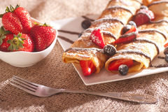 Pancakes served with strawberries, blueberries and chocolate Stock Image