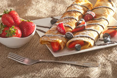 Pancakes served with strawberries, blueberries and chocolate Royalty Free Stock Photography