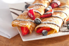 Pancakes served with strawberries, blueberries and chocolate Stock Photo