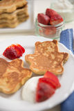 Pancakes in the shape of a bear Stock Images