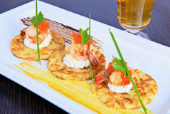 Pancakes with shrimps and caviar Stock Photography