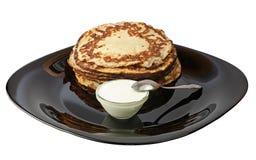 Pancakes with sour cream. Stock Photos