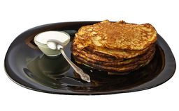 Pancakes with sour cream. Stock Image