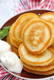 Pancakes with sour cream Royalty Free Stock Image