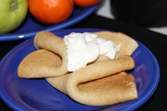 Pancakes with sour cream for breakfast. royalty free stock images