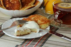 Pancakes with sour cream and a cup of tea for breakfast Stock Photos