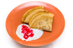 Pancakes with sour cream. Delicious pancakes with sour cream and currant jam Stock Photography