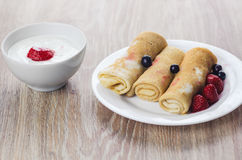 Pancakes with sour cream Royalty Free Stock Photos