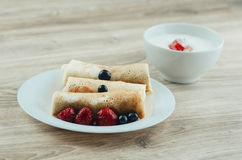 Pancakes with sour cream Royalty Free Stock Images