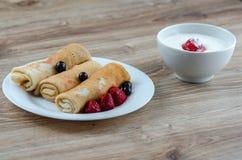 Pancakes with sour cream stock photo