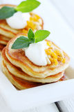 Pancakes with sour cream Stock Photos
