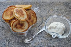 Pancakes with sour cream in glass vases Royalty Free Stock Image
