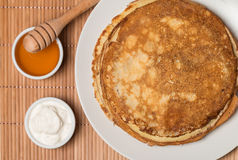 Pancakes with sour cream and honey Royalty Free Stock Photography