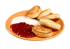 Pancakes with sour cream and jam Stock Photography