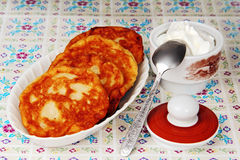 Pancakes and sour cream. Royalty Free Stock Images