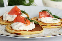 Pancakes with sour cream sauce with salmon. Royalty Free Stock Photo