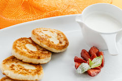 Pancakes with sour cream and strawberries Stock Images