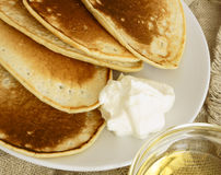 Pancakes with sour cream and syrup. Pancakes with sour cream, in Russian tradition Stock Image