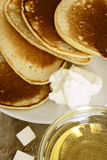 Pancakes with sour cream and syrup. Pancakes with sour cream, in Russian tradition Stock Photo