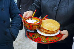 Pancakes with sour cream on a tray Stock Images