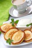 Pancakes with sour cream Stock Photos