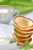Pancakes with sour cream Stock Photography