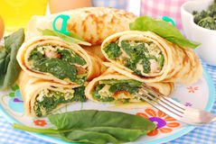 Pancakes with spinach and eggs Stock Images