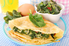 Pancakes with spinach and eggs Stock Photography