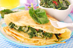 Pancakes with spinach and eggs for child Stock Images