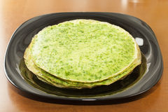 Pancakes with spinach Stock Image