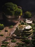 Pancakes with spinach and pumpkin seeds on a wooden table. Count Stock Images