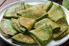 Pancakes with spinach on white plate Royalty Free Stock Photography