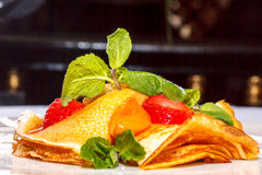Pancakes sprinkled with fruit and berries Royalty Free Stock Photography