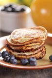 Pancakes. Stack of pancakes with blueberries and orange juice stock photography