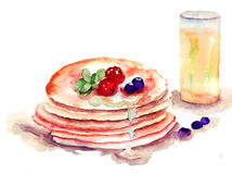 Pancakes stack with fresh berries and juice Royalty Free Stock Photos