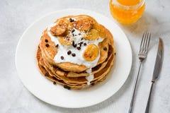Pancakes stack with yogurt, caramelized banana and chocolate Royalty Free Stock Image