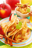 Pancakes with stewed apples ,raisins and honey Royalty Free Stock Photos